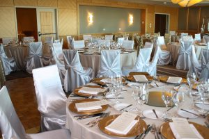 Guest chairs: White satin universal chair covers