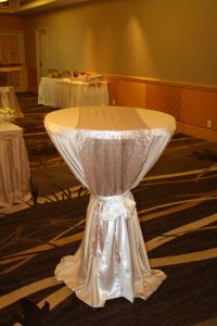 Cocktail table: White satin tablecloth with blush pink sequin runner tied with white satin sash