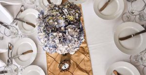 Wedding party guest tables: Champagne pintuck runners